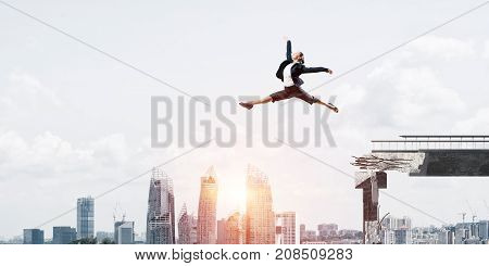 Business woman jumping over huge gap in concrete bridge as symbol of overcoming challenges. Cityscape with sunlight on background. 3D rendering.