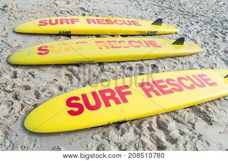 Melbourne, Australia - February 11, 2017: Surf Rescue surfboards on Aspendale Beach in Melbourne. Surfboards are a commonly used tool for lifesavers.