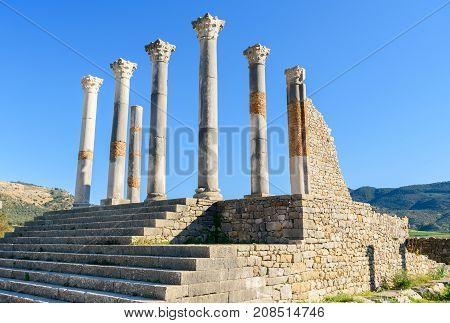 Capitoline Temple In Roman Ruins, Ancient Roman City Of Volubilis. Morocco