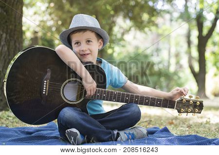 He Loves Playing Guitar