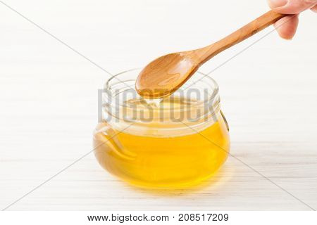Wooden Spoon With Floral Honey On The Jar