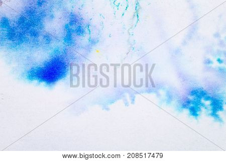 Macro shot of abstract hand drawn blue and magenta watercolor paints background. Stained texture