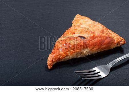 Food concept Fresh bake Homemade meal beefs or chicken triangle puff pie on slate stone with copy space