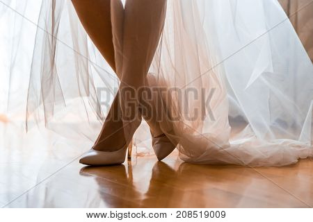 The Bride's Legs In The Night Dress In The Back Light.