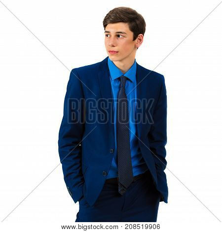 Portrait of a handsome serious teenager in a suit on a white background
