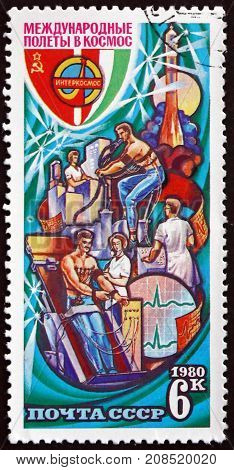 RUSSIA - CIRCA 1980: a stamp printed in the Russia shows Emblem and Training Lab Intercosmos Cooperative Space Program USSR-Hungary circa 1980