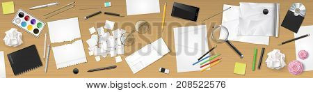 Conceptual banner of the workplace of the table. Creative chaos. Stationery