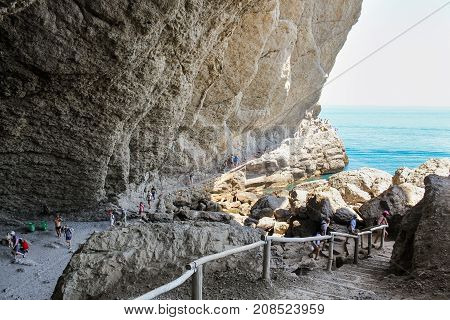 New World, Crimea - 12 July, People on the trail under the rock, 12 July, 2017. Travel along the coast along the path of Prince Golitsyn.