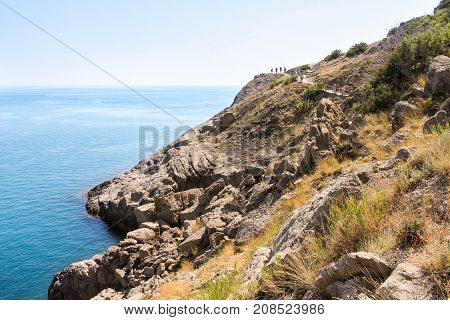 New World, Crimea - 12 July, Rocky slope to the beach, 12 July, 2017. Travel along the coast along the path of Prince Golitsyn.