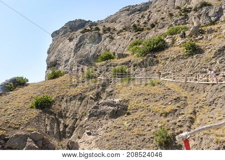 New World, Crimea - 12 July, People on the path with a fence, 12 July, 2017. Travel along the coast along the path of Prince Golitsyn.