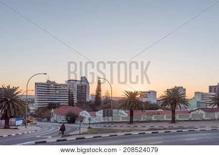 WINDHOEK NAMIBIA - JUNE 16 2017: A street scene with buildings at sunset in Windhoek the capital city of Namibia