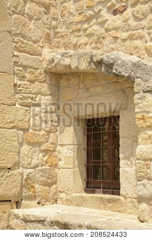 Window on stone house in the medieval village of Pals located in the middle of the Emporda region of Girona Catalonia Spain. poster