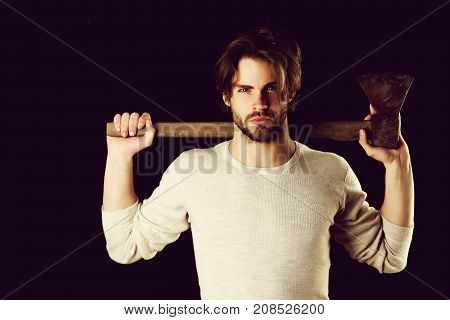 Brutal Bearded Man With Stylish Hairdo Holds Old Axe