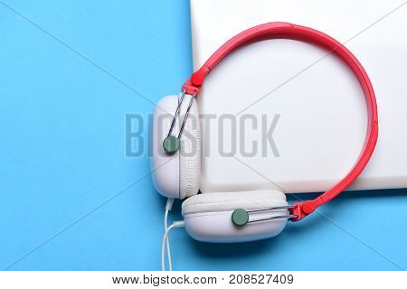 Headphones And Silver Laptop. Sound Recording Concept