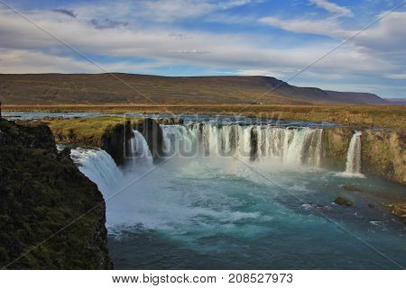 Famous waterfall Godafoss in autumn. Scene in north Iceland.