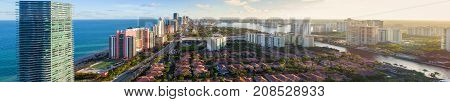 Aerial panoramic image Sunny Isles Beach sunset over the west
