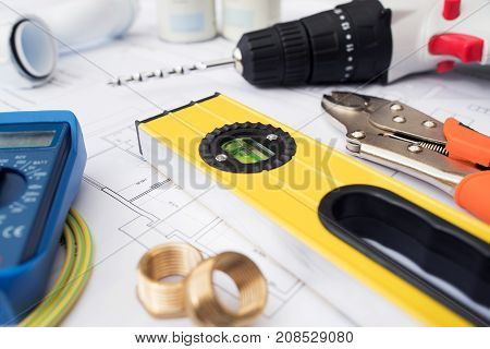 Building Tools And Components Arranged On House Plans