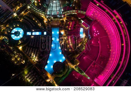 MIAMI BEACH, FL, USA - OCTOBER 9, 2017: Aerial night image of the Fontainebleau Hotel and Resort Collins Avenue 44th Street