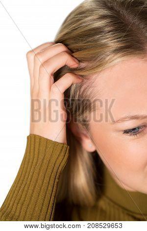 Studio Shot Of Young Woman Itching Scalp