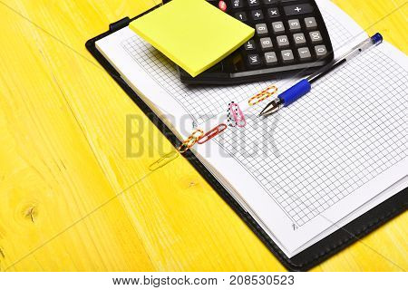 Calculator, Notebook, Paper Clips, Pen And Sticky Notes, Close Up