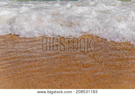 Big close foam wave on sea close with beach