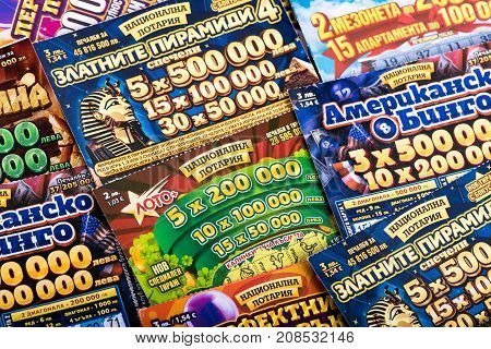 SOFIA, BULGARIA - September 07, 2017: Pile of different Bulgarian national lottery scratch tickets