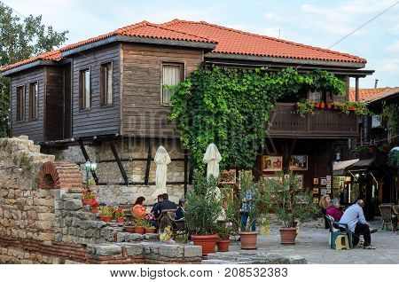 NESSEBAR, BULGARIA - September 20, 2014 : Ruins of St. Sophia church and people at nearby coffee shop