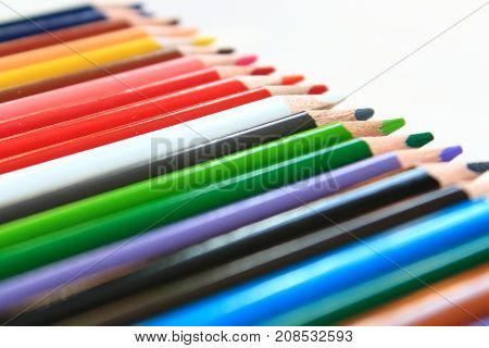 Сolored pencils on white background. Colored pencils for painting. Pencils for school and work. Accessories for painting, drawing. Stationery, office supplies