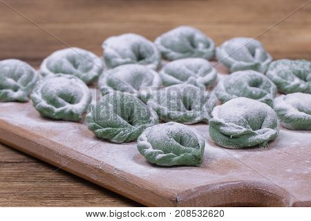 Green Crude Pelmeni With Spirulina. Ukrainian And Russian Dishes - Vareniki Or Dumplings With Beef M