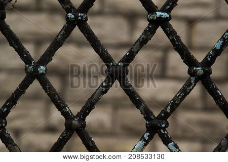 Rusty Chain Link Fence on gray background gray and black abstract closeup of a chain link backgroundclose-up