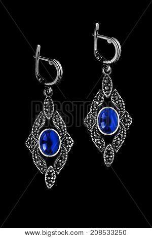Vintage silver sapphire earrings on black background