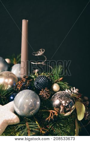Christmas floral composition. a New Year's bouquet with candles. in dark tones background