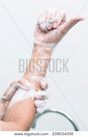Nurse perform surgical hand washing Preparation to the operating room. Closed-up of the hands.
