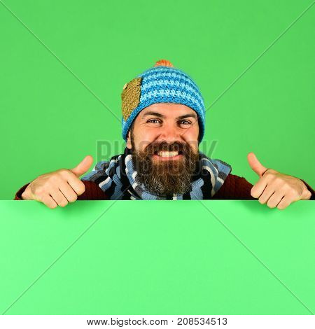 Hipster With Beard And Smiling Face Wears Warm Clothes