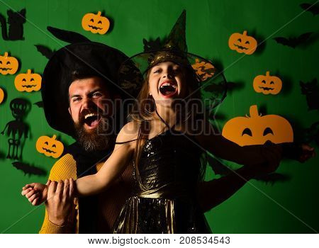 Wizard And Witch In Black Hats. Girl And Bearded Man