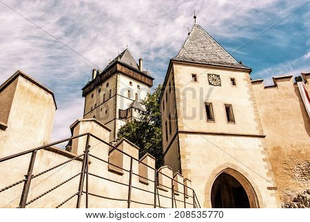 Gothic castle Karlstejn in Czech republic. Ancient architecture. Travel destination. Yellow photo filter.