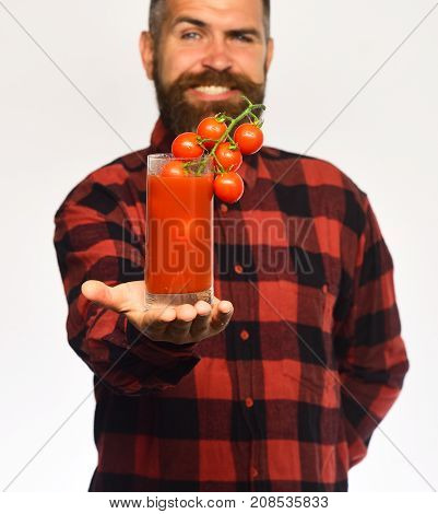 Guy With Homegrown Harvest. Man With Beard Holds Tomato Juice