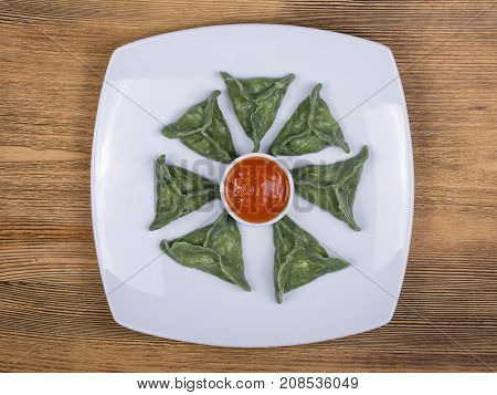 Green Dim Sum, Chinese Food. Dumplings With Beef Meat Or Mashed Potatoes Or Cottage Cheese In The Do