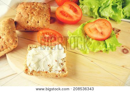 veggie burger with tomatoes cheese and lettuce closeup