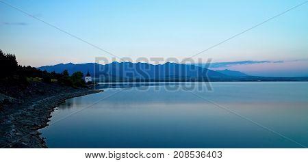 View on level water in dam Liptovska Mara with the background of the Havranok church.