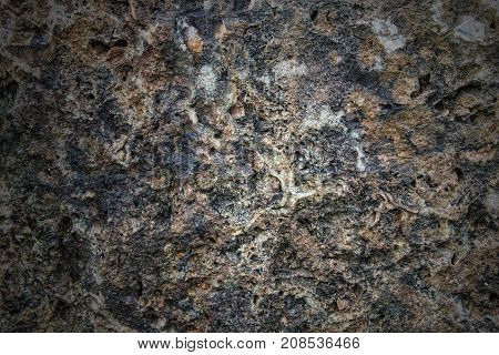 Stone wall background made from stone decorative uneven cracked real stone wall surface with cement