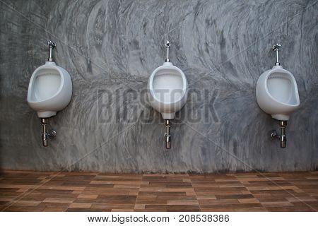 Closeup Of Three White Urinals In Men's Bathroom Design Of White Ceramic Urinals For Men In Toilet R
