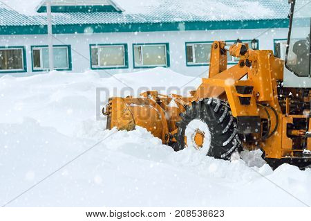 Snow clearing. Tractor clears the way after heavy snowfall.