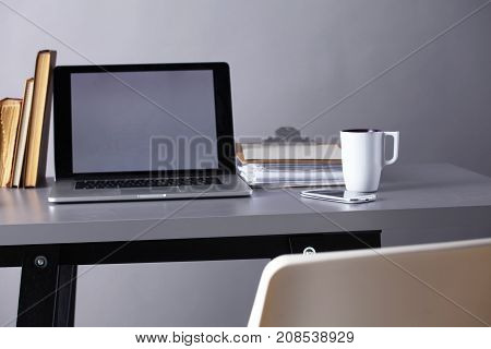 Workspace with computer and document in office .