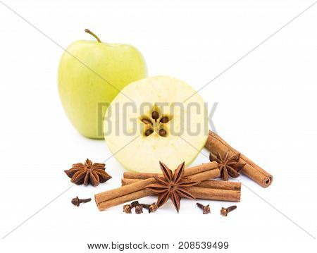 Apple, star anise, cloves and cinnamon isolated on white background