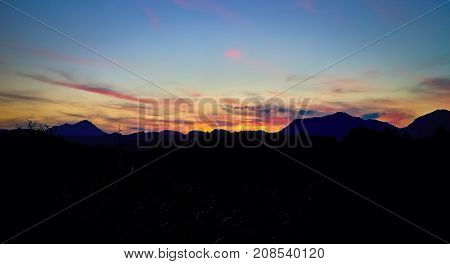 Autumn sunset over the Choc mountains on Liptov in Slovakia. Mountains sky and colors background