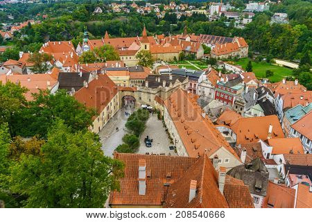 Castle Krumlov and Cesky Krumlov. Medieval fortress and the river Vltava. Red tile and narrow streets. Houses made of stone. Medieval houses. Czech Republic