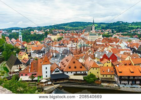 Cesky Krumlov. Medieval fortress and the river Vltava. Red tile and narrow streets. Houses made of stone. Medieval houses