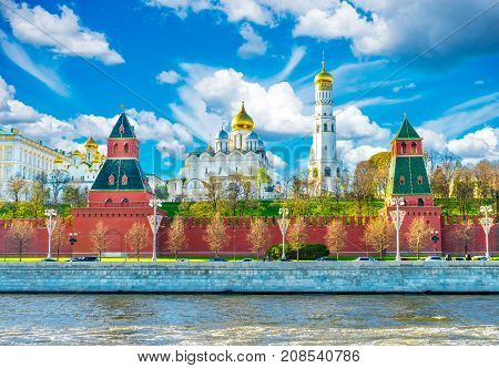 Moscow Kremlin. Towers of the Moscow Kremlin. The bell tower of Ivan the Great and the Annunciation Cathedral in the Moscow Kremlin. Moscow Kremlin against the background of a cloudy sky