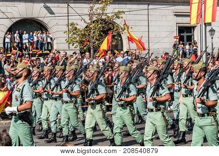 Madrid Spain - October 12 2017: Legionarios marching in Spanish National Day Army Parade. Several troops take part in the army parade for Spain's National Day.